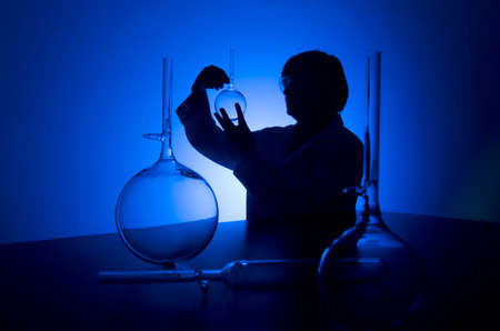 Silhouette of a female researcher carrying out research in a chemistry lab Stock Photo - 10133712