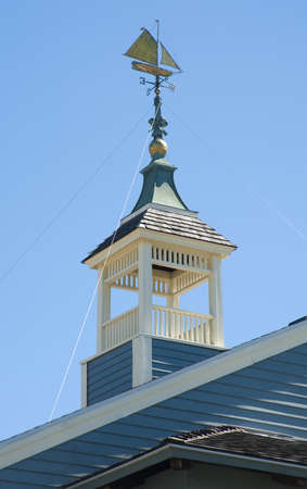 forcast: Weathervane in the form of a sailing ship on a roof cupola
