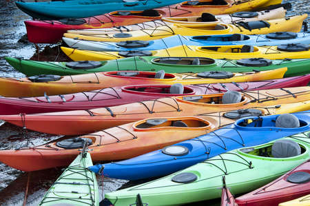 tethered: Colorful fiberglass kayaks tethered to a dock as seen from above