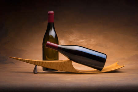 red wine pouring: 2 Wine bottles on modern japanese stand Stock Photo