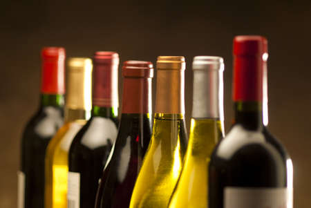 Wine bottles in a row with limited depth of field Banque d'images