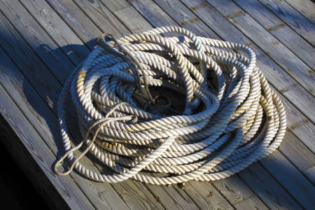Coiled nautical rope on a boat dock photo