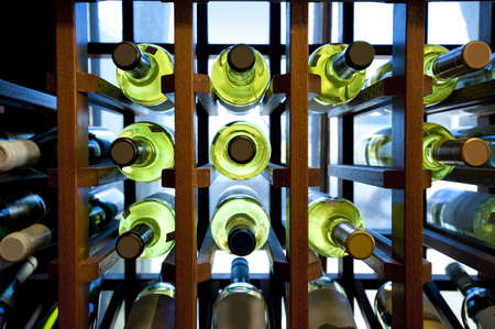 Wine bottles in wooden rack located in a small country store photo
