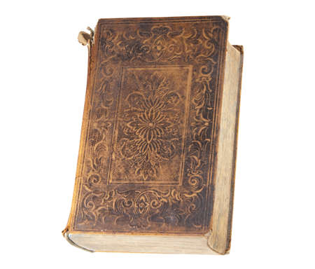 Antique book with frayed leather cover, isolated with clipping path photo