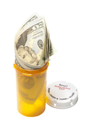 Cost of drugs metaphor of money in a prescription bottle photo