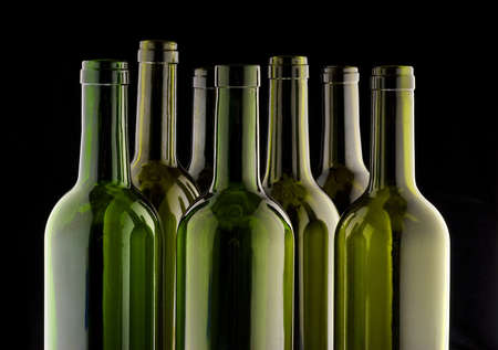 Wine bottles side lit on a black velvet background Stock Photo - 11438724