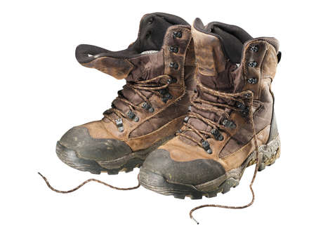 A pair of old hiking boots isolated on white background  Фото со стока