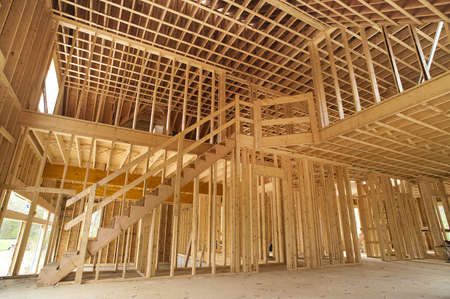 timber frame: Interior framing of a new house under construction Editorial