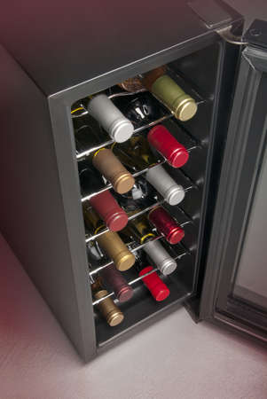Wine cooler in home basement photo