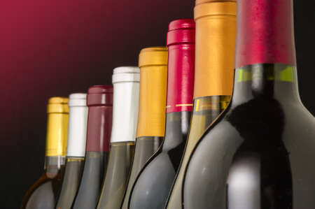 degustation: Wine bottles in a row with limited depth of field Stock Photo