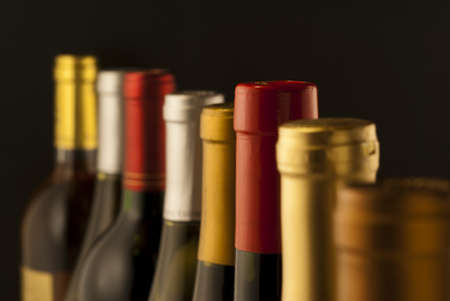 brown bottle: Wine bottle necks with limited depth of field Stock Photo