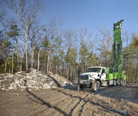 drilling well: Drilling new well at a home construction site