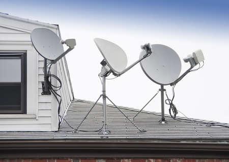 parabolic mirror: Satellite TV antenna on roof