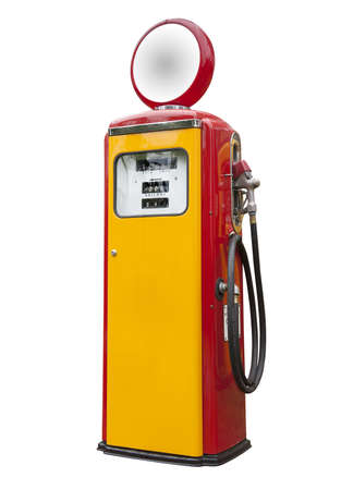 antique gas pump in yellow and red, isolated photo