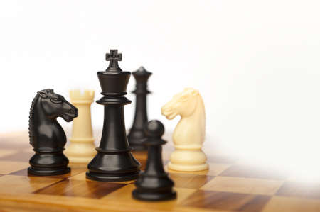 chellange: chess pieces on a white background advising to strategic behavior