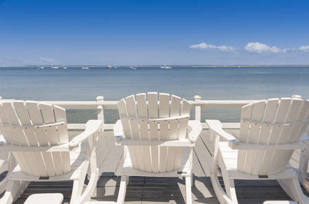 beach chairs overlooking tranquil ocean  on old cape cod