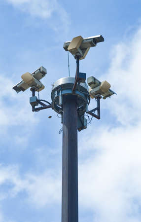 close circuit camera: Three outside security cameras cover multiple angles.  Stock Photo