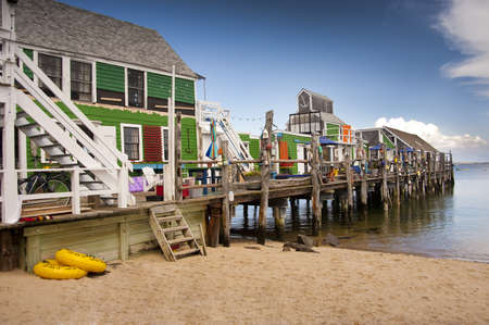 Fishing sheds turned into summer living quarters Stock Photo