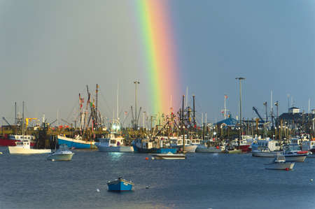 Rainbow over  harbor after the storm photo