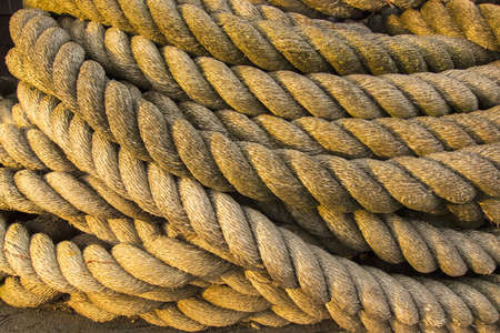 Rope on dock used to fasten big ships to cleats on dock Stock Photo