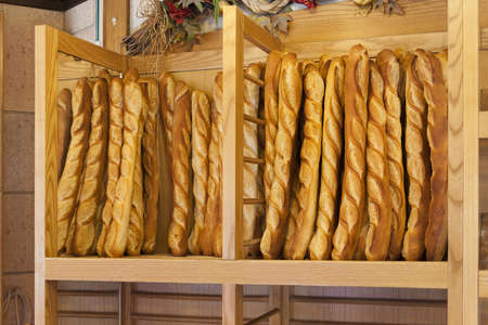 boulangerie: Bread baguettes standing up in a French bakery or boulangerie