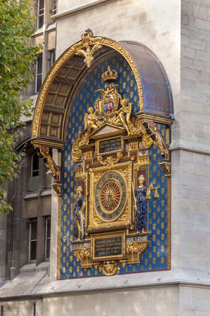 corner clock: Wall clock on the corner of the Palais de Justice in Paris, France.  Editorial