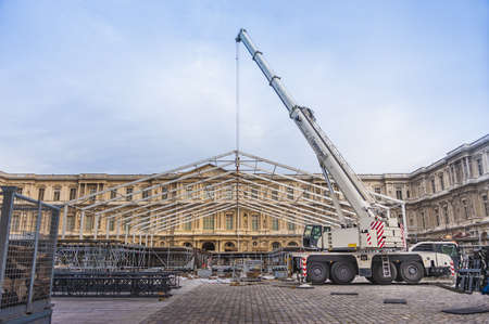 erecting: Big mobile construction crane erecting a temporary structure