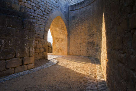 gateway: Castle archway lit by the setting sun