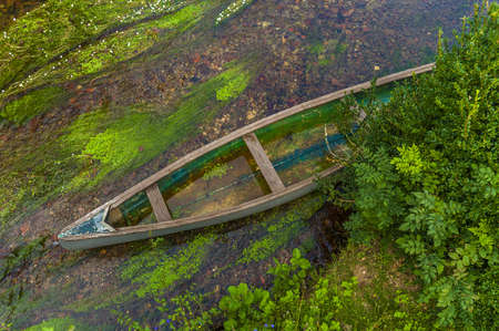 Canoe in shallow river photo