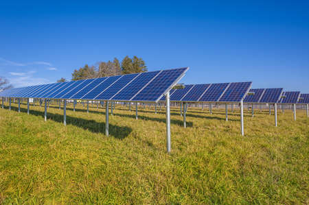 Solar panels in field with blue sky Stock Photo - 16682194