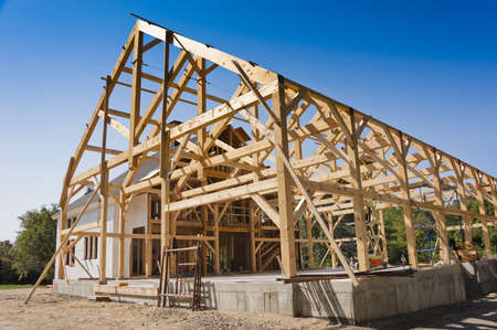 timber frame: New house post and beam construction Stock Photo