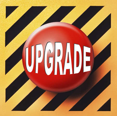 Upgrade button in red over an orange and black background Stock Photo - 17038405