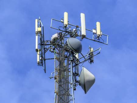 cell phone tower: Telecommunications equipment - directional mobile phone antenna dishes. Wireless communication. Stock Photo