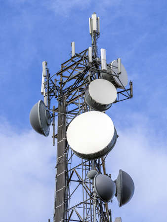 Telecommunications equipment - directional mobile phone antenna dishes. Wireless communication. Stock Photo - 17018806
