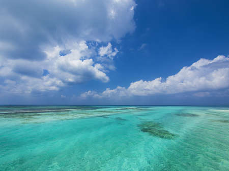 Tropical aquamarine sea and clouds in paradise