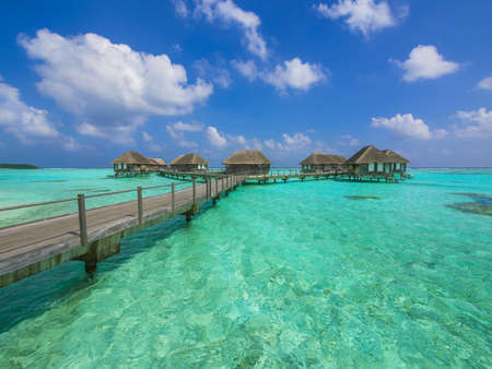 Water bungalows at a tropical island - travel background Stock Photo - 18148553