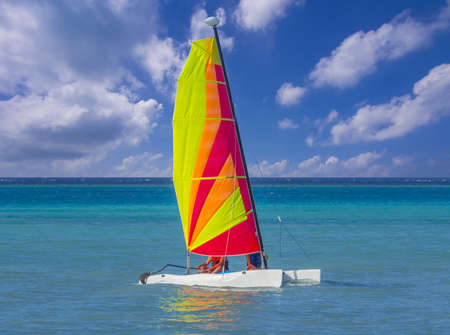 Catamaran sailboat in caribbean sea on blue sky background Stock Photo - 18279724