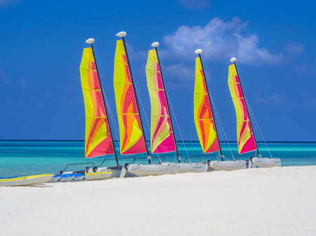Catamaran sailboats on white sandy beach Stock Photo - 18279725