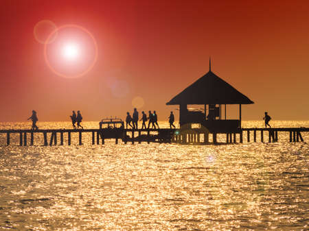 hot day: Dock off tropical waters on a hot day