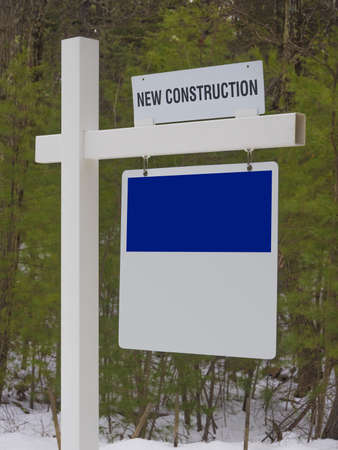 Sign post to new house development photo