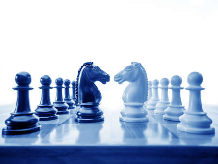 chess knight: Chess conflict in blues Stock Photo
