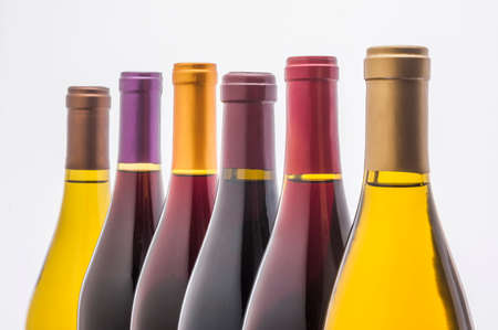 noire: wine bottles in a row back lit on white Stock Photo