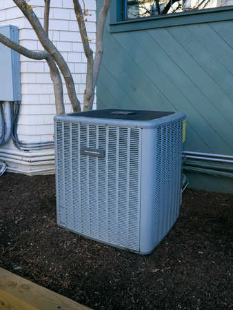 outside machines: Heating and air conditioning residential unit Stock Photo