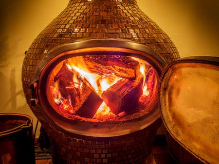 woodburning: Wood stove with logs burning inside