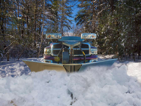 heap snow: Truck plowing the snow Stock Photo