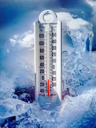 Ice cold thermometer in ice and snow