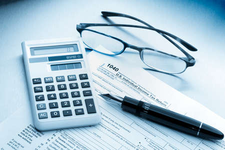cpa: Tax preparation with fountain pen and forms Stock Photo