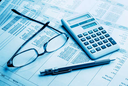 accounting work space with calculator,pen and profit and loss statements