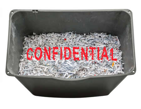confidential: Shredded paper documents for security