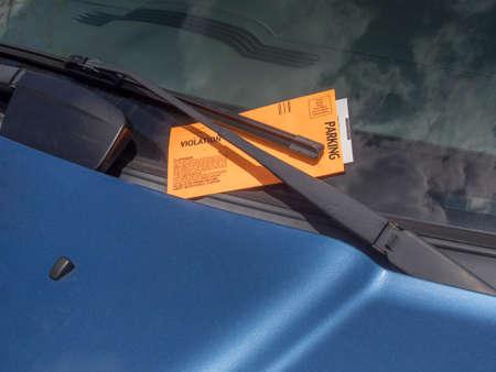 parking ticket: parking ticket on motor car windscreen or windshield